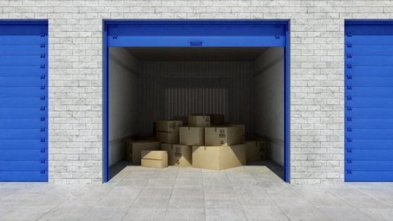 Open self storage unit full of cardboard boxes. 3d rendering